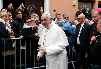 Pope Francis greets faithful as he arrives at the Gate of Dawn shrine in Vilnius