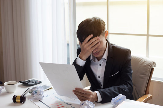 Businessman feeling sick and tired. Businessman who feel stressed out of work