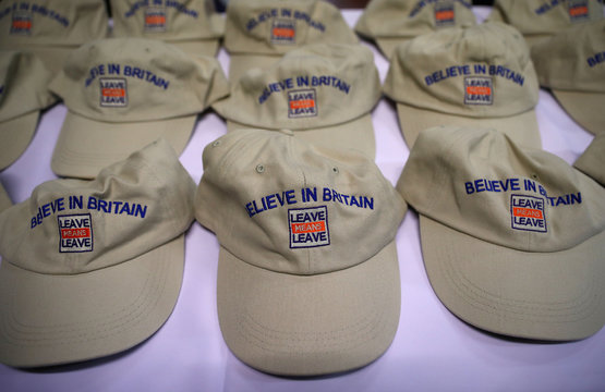 Branded baseball hats await the arrival of Brexit supporters at a 'Leave Means Leave' rally at the University of Bolton, in Bolton