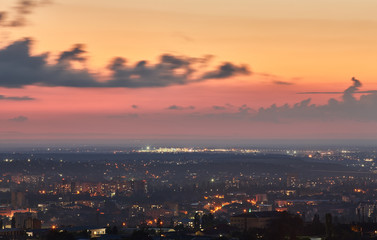 Crimea. Simferopol from a bird's-eye view in the rays of the setting sun. The city is in the backlight..