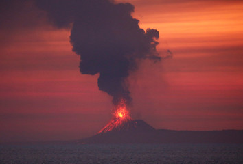 Anak Krakatau (Child of Krakatoa) volcano is seen from Japanese helicopter carrier Kaga at the Indian Ocean