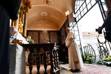 Pope Francis visits the Shrine of Divine Mercy in the Chapel of the Gate of Dawn in Vilnius