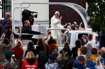 Pope Francis greets faithful as he arrives outside the Vilnius Cathedral in Vilnius
