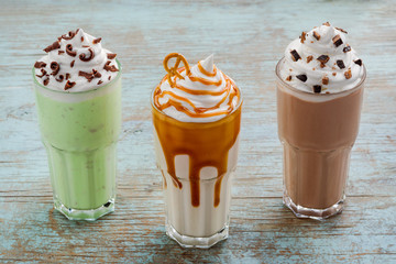 Three massive portions of milkshakes