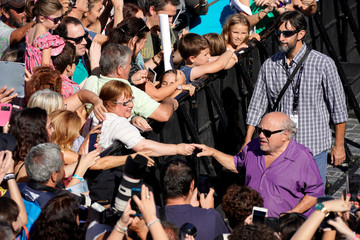 U.S. actor Danny DeVito greets fans following a photocall to promote the feature film Smallfoot at the San Sebastian Film Festival