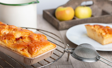 Home made apple pie on a wooden table
