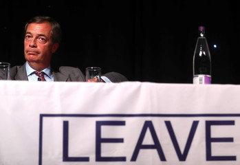 Pro-Brexit supporter and ex-leader of UKIP, Nigel Farage listens to ex-Secretary of State for Exiting the European Union, David Davis, addressing a 'Leave Means Leave' rally at the University of Bolton, in Bolton