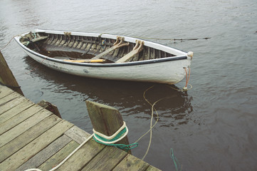 Old dory tied to a wharf in Peggy's Cove, Nova Scotia.