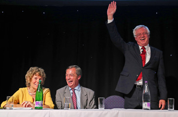 Pro-Brexit supporter and ex-leader of UKIP, Nigel Farage and Labour MP Kate Hoey congratulate ex-Secretary of State for Exiting the European Union, David Davis, after he had addressed a 'Leave Means Leave' rally at the University of Bolton, in Bolton