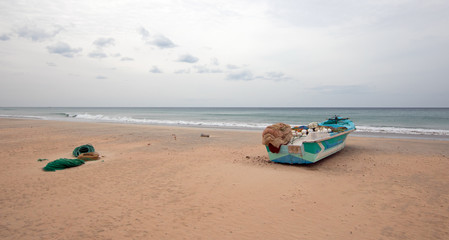 Small boat on Nilaveli beach in Sri Lanka Asia