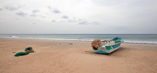 Small boat on Nilaveli beach in Sri Lanka Asia