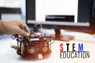 Student learning STEM Education robotics for creating project based studying for innovation robot model. New study generation for DIY electronic Kit in computer teachnology classroom
