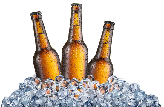 Three cold bottles of beer in the ice cubes.
