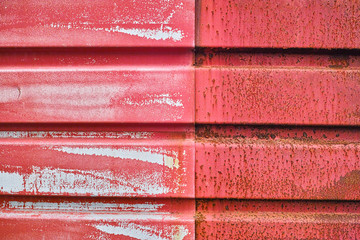 red old metal wall with scratches and rust