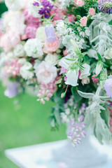 Blurry image with focus on bridalbouquet of flowers. Concept of floristic art and wedding decorations.