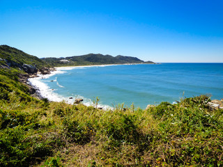 A view of the Atlantic ocean from a hiking path in Florianopolis, Brazil