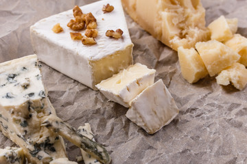 set of different cheeses on a wooden rustic background
