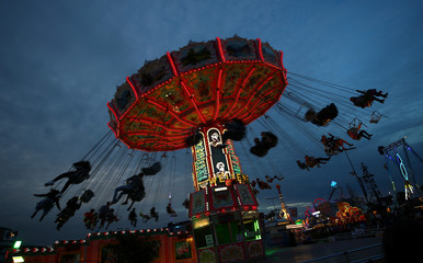 Visitors ride a merry-go-round during the opening day of the 185th Oktoberfest in Munich