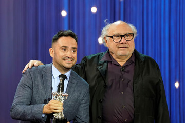 Film director Juan Antonio Bayonna jokes with U.S. actor Danny DeVito during the presentation of DeVito's Donostia Award for Lifetime Achievement at the San Sebastian Film Festival