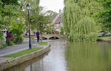 River Windrush wending its way through the quaint village of Bourton on the Water, Gloucestershire in the Cotswold region of England