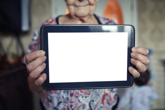 elder woman holding tablet