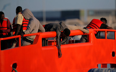 Migrants are seen on a rescue boat at the port of Malaga