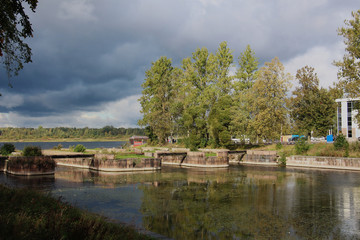 landscape on the canal bank in inclement weather on the eve of a storm