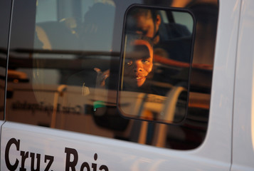 A migrant woman is seen in a van of the Spanish Red Cross after disembarking a rescue boat at the port of Malaga