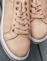 fragment of beige leather women's shoes with laces