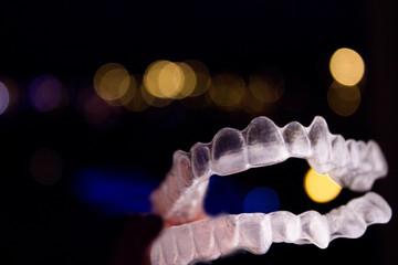 Transparent dental orthodontics to correct dental alignment