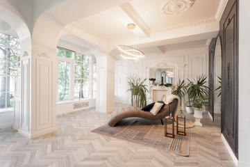 interior in hotel. daylight in the interior and light of electric lamps. luxury living room with parquet wood floors, fireplace, sofa and houseplant. Stucco on walls