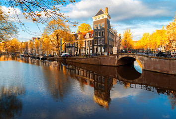 Dutch city scenery with canal and mirror reflections, Amstardam, Netherlands at fall