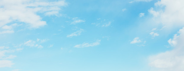 Wide Angle Blue sky Wallpaper with soft white clouds