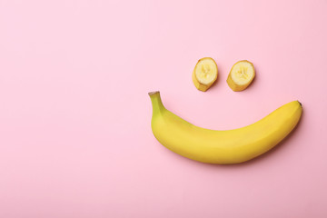 Funny flat lay composition with bananas on color background. Space for text