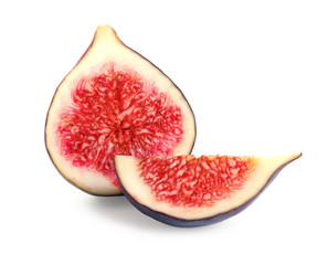 Pieces of ripe purple fig on white background