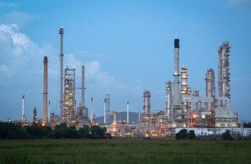 Oil refinery plant at twilight with blue sky.