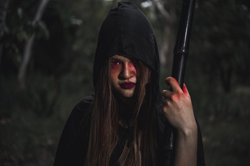 Woman ghost horror her have scythe on hand in forest,