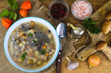 Delicious hot soup with wild mushrooms and potatoes