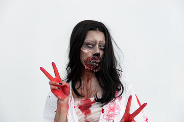 Portrait of asian woman make up ghost face with blood on white background,Horror scene,Scary background,Halloween poster,Thailand people