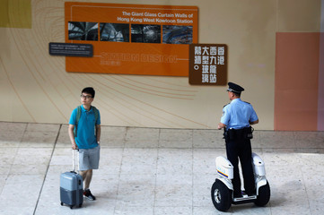 A Chinese policeman patrols at mainland's jurisdiction inside West Kowloon Terminus at the first day of service of the Hong Kong Section of the Guangzhou-Shenzhen-Hong Kong Express Rail Link, in Hong Kong