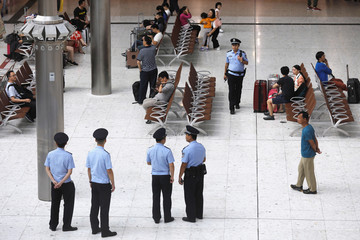 Chinese policemen stand guard at mainland's jurisdiction inside West Kowloon Terminus at the first day of service of the Hong Kong Section of the Guangzhou-Shenzhen-Hong Kong Express Rail Link, in Hong Kong