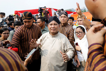 Prabowo Subianto, challenger to incumbent President Joko Widodo, leaves a ceremony marking the start of the campaigning period for next year's election in Jakarta