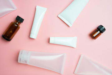 flat lay with cosmetic products tubes branding