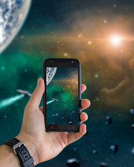 Hand with mobile phone taking snapshot of space. Elements furnished by NASA. 3D rendering