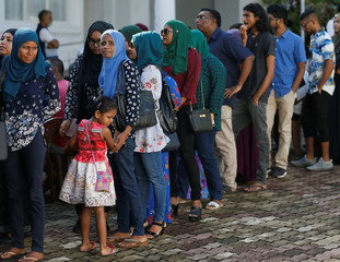 Maldivians living in Sri Lanka stand in a line to cast their vote during the Maldives presidnetial election day at the Maldives embassy in Colombo