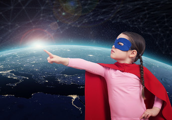 Girl power. Superhero kid against the Earth. 3D rendering elements of this image furnished by NASA