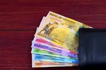 Ugandan Shilling in the black wallet