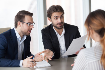 Male recruiters surprised by work achievements or experience in resume of female job applicant during interview, amazed HR managers shocked with woman candidate career. Good first impression concept
