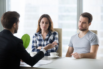 Unhappy couple dislike house offer from realtor or architect, boyfriend and girlfriend buying first home together dissatisfied with option prepared by broker, man and woman bored at meeting with agent