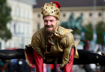 A man dressed in historical clothes takes part in the Oktoberfest parade in Munich